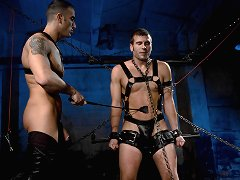 Two comic heroes studs fight and fuck in bondage.
