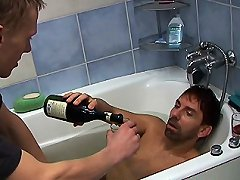 Guys drank too much and decided to relax in a warm bath. They kiss so wet and nasty that it makes you wanna join them and keep on watching the way they shag and console their cocks for anal penetration and wet tasty blowjobs. Wet gay naked bodies look stu