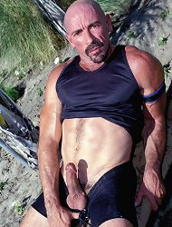 Horny bear Steven is enjoying the outdoors by masturbating hard and fast