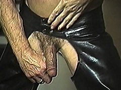 Leather clad old guy masturbates