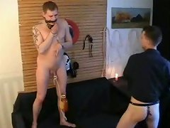 Bent like a bow, the boy is forced to suck the shaft of his master!
