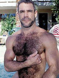 Horny bear stud Jeremy chills by the pool and plays with his erect meaty dick