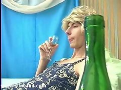 Guy in dress and blond wig sucks cock and fucks his ass with a bottle after a few drinks