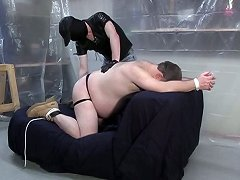 Tied up and bent over, this bear slave\'s white is an easy target for his master\'s smacks