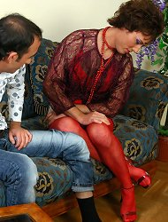 Spicy sissy in his see-through blouse and red stockings going for doggie