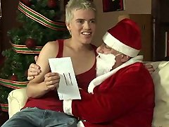 Santa gives a twink a cock to suck for Christmas
