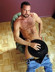 Hot cowboy gay bear Phil strokes his huge staff and plays with his hairy chest
