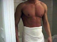Cute muscular stud getting ready to shower