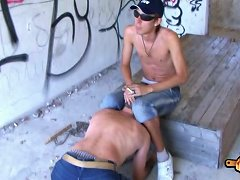 Young skinny torturer humiliates his slave and beats him with a wooden plank