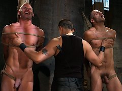Van Darkholme works over two hard naked slaves.