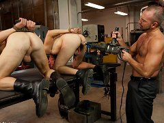 Josh West ties up and fucks Luke Riley and Kain Warn in the metal shop.