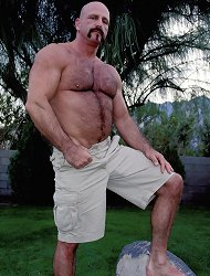 Hunky buffed bear gay Jasper takes off his pants to show his erect cock outdoors